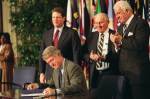 Photographer: Paul J. Richards/AFP President Bill Clinton signs the North American Free Trade Agreement on Dec. 8, 1993.