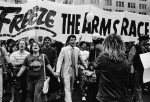 Demonstrators march hand in hand toward Central Park under a large banner reading, 'Freeze The Arms Race,' during a massive Nuclear Disarmament Rally, where about 750,000 gathered to rally for a nuclear arms freeze, New York City, New York, June 12, 1982. (Photo by Lee Frey/Authenticated News/Getty Images)
