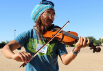 Jimmy Betts plays the fiddle in the Mojave Desert. He carried the fiddle on a march from Los Angeles to Washington to call attention to climate change. (Kelsey Erickson)