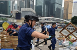 Police clear the Occupy site in Admiralty last December. Yeung was arrested during the operation. Photo: AFP