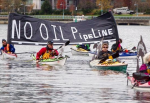 "Kayakers display a ""No Oil Pipeline"" banner during a protest against the Enbridge Northern Gateway pipeline in Vancouver, in this Nov. 16, 2013 file photo. Photograph by: DARRYL DYCK, THE CANADIAN PRESS/file"