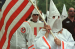 Members of the Church of the American Knights of the Ku Klux Klan march around the Madison County Courthouse in Canton, Miss. (AP Photo/Rogelio Solis)