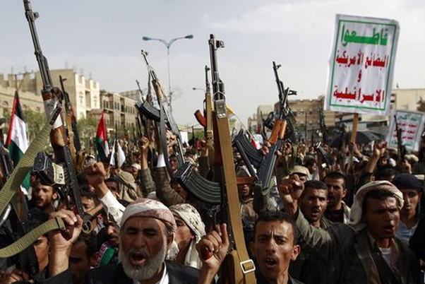 Yemeni supporters of the Shiite Huthi movement raise their weapons July 10 during a rally to mark the Quds (Jerusalem) International day in support of Palestinians in the Sanaa, Yemen. (Photo: Mohammed Huwais/AFP)