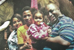 Eric Garner, pictured here with his family, died after a police officer held him in a chokehold during an arrest on July 17, 2014  Read more: http://www.dailymail.co.uk/news/article-3157948/Eric-Garner-s-family-awaits-closure-year-chokehold-death-cop-lock-says-t-wait-work.html#ixzz3fmrdnkqU  Follow us: @MailOnline on Twitter | DailyMail on Facebook