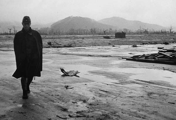 A Japanese soldier walks through a leveled area in Hiroshima, Japan in September of 1945, one month after the detonation of a nuclear bomb above the city. From a series of U.S. Navy photographs depicting the suffering and ruins that resulted from the blast. (U.S. Department of Navy)