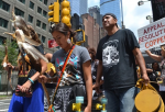 Members of the Apache tribe in Times Square, New York, on Friday. Photograph: Avaaz
