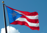 Puerto Rico is being put into an austerity vice by US hedge funds. (Photo of Flag of Puerto Rico: Damian Entwistle)