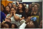 People react in opposition as D.C. Mayor Muriel Bowser  increases in police activity during a press conference at the former Malcolm X Elementary School in Congress Heights. (Katherine Frey/The Washington Post)