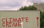 Climate change activists' graffiti on a billboard near the Didcot coal-fired power station in Oxfordshire, UK. Photograph: Tim Myers