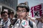 Occupy Central leader Joshua Wong speaks to the media after a vote at the city's legislature in Hong Kong, June 18, 2015.