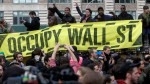 Occupy Wall Street holding banner