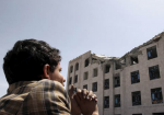 A Houthi militant sits amidst debris from the Yemeni Football Association building, which was damaged in a Saudi-led air strike, in Sanaa May 31, 2015. (photo: Mohamed al-Sayaghi/Reuters)