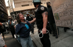 A protester is arrested on September 16, 2012 (Jessica Lehrman / Gothamist)
