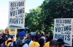 Demonstrators gather and display signs at the Restore the VRA rally in Washington, DC, September 16, 2015. (Photo: NAACP / ADC National)