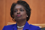 Federal Communications Commission Commissioner Mignon Clyburn listens to a fellow commissioner speak during an FCC hearing on Feb. 26, 2015.