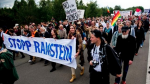 Protesters gather outside the US Ramstein Air Base, in Rhineland-Palatinate, Germany, September 26, 2015.