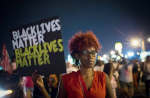 On August 8 in Ferguson, Missouri, demonstrators mark the first anniversary of the death of Michael Brown. (Scott Olson / Getty Images)