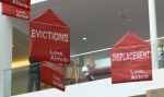 Protesters' banners hung from balloons in Airbnb's atrium Photograph: David Zlutnick