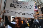 Joanna Pianko protests with Occupy Chicago outside the Federal Reserve Bank October 3, 2011 in Chicago, Illinois. The demonstrators are protesting what they believe is greed and corruption among banking and business leaders who corrupt democracy.  (Photo by Scott Olson/Getty Images)