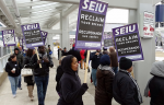 About 50 supporters of unionized Twin Cities janitors picket outside Minneapolis-St. Paul International Airport's Terminal 1 on Wednesday afternoon. Thousands of union members are expected to participate in the 24-hour strike. Riham Feshir | MPR News