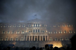 Smoke rises from a fire set by protesting farmers during a demonstration against planned pension reforms in front of the parliament building in Athens, Greece February 12, 2016. REUTERS/ALKIS KONSTANTINIDIS