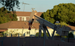 An oil pump-jack runs near homes in the Los Angeles neighborhood of Wilmington. (AP Photo/Mark J. Terrill)