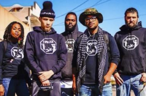 Ramsey Orta stands second from the left with other Copwatch activists. A resident of Staten Island, Orta has endured repeated harassment from the NYPD since his phone video of the police killing of Eric Garner went viral. Courtesy of Copwatch.