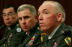 Alex Wong, Getty, AFP | Major General Geoffrey Miller (right) testifies during a hearing on the Abu Ghraib prison scandal on May 19, 2004, in Washington, DC.