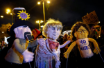 A rally in Madrid this month protested the arrests of two puppeteers accused of glorifying terrorism and promoting hatred. The puppeteers could face up to seven years in prison. Credit Fernando Alvarado/European Pressphoto Agency