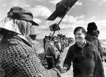 Cesar Chavez Proudly, shaking a united farm workers hand during a lettuce strike.