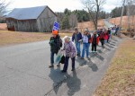 Pipeline protestors walk in Ashfield on their way to Shelburne Falls on Friday.
