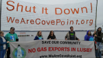 Kayactivists on land and water protest Dominion at Solomon's Island in Cove Point community, by Jimmy Betts.