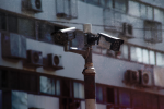 Surveillance Camera via Shutterstock; Edited: LW / TO