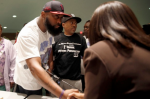 Michael Brown Sr. shakes hands with a Ferguson City Council member. Jeff Roberson / AP