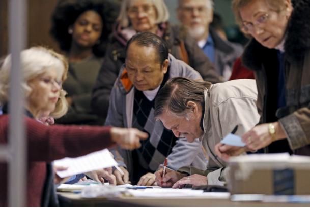 Votes are counted during Minnesota's Democratic caucus. Reuters/Eric Miller