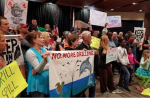 Defenders of Land, Water and Climate Take Over Federal Oil Lease Sale at the New Orleans Superdome. Photo by Indigenous Environmental Network