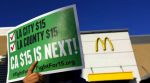 Protesters carry signs for higher wages in the parking lot at a McDonalds in South Los Angeles in 2015. (Photo: Mark Boster / Los Angeles Times)