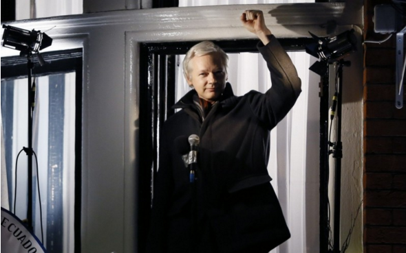 Julian Assange, founder of WikiLeaks gestures as he speaks to the media and members of the public from a balcony at the Ecuadorian Embassy in London, Thursday, Dec. 20, 2012. (Photo: Kirsty Wigglesworth/AP)