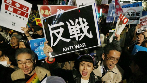 Demonstrators protest against the new security law as they rally outside the Diet building in Tokyo. (Photo: AFP)