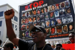 A man shouts slogans while people take part in the Million People's March Against Police Brutality, Racial Injustice and Economic Inequality in Newark, New Jersey July 25, 2015. REUTERS/EDUARDO MUNOZ