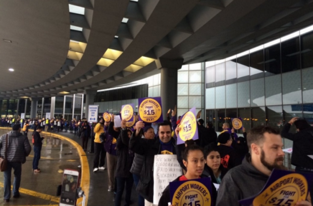 Striking workers march outside of O'Hare Airport in Chicago this morning. (SEIU Local 1 / Twitter)