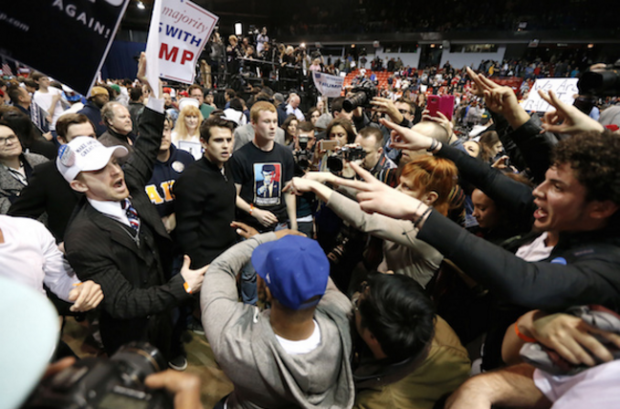 Supporters, at left, of Republican presidential candidate Donald Trump face off with protesters after a rally was canceled last month at the University of Illinois, Chicago, over security concerns. (Charles Rex Arbogast / AP)