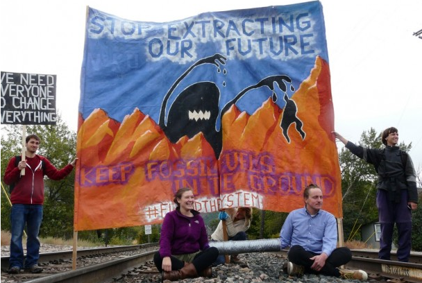 Protesters block a coal train from entering downtown Missoula in 2015. (Blue Skies Campaign)