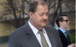 F. BRIAN FERGUSON | Gazette-Mail Former Massey Energy Co. CEO Don Blankenship makes his way into the Robert C. Byrd U.S. Courthouse, in Charleston, for his sentencing Wednesday morning.