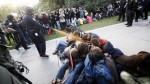 Then-UC Davis police Lt. John Pike hits protesters with pepper spray on Nov. 18, 2011.   (Wayne Tilcock / Associated Press)