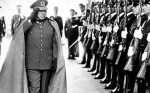 Former Chilean dictator General Augusto Pinochet reviews troops as he enters La Moneda Palace in the capital Santiago. (photo: Reuters)