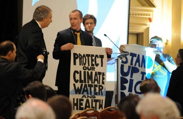 Protestors interrupt as Norman Bay, center, Chairman of the Federal Energy Regulatory Commission (FERC), gives the key note during the Independent Power Producers of New York 30th Annual Spring Conference & Showcase at The Desmond on Wednesday May 11, 2016 in Colonie , N.Y. (Michael P. Farrell/Times Union)