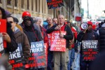 Verizon workers form a picket line outside one of the phone and internet provider's locations in the Manhattan borough of New York, April 13, 2016. Some 36,000 employees who had been working without contracts for eight months walked off the job after the company and two labor unions failed to reach a deal on proposed pension cuts and rules regarding outsourcing jobs. (Nicole Bengiveno / The New York Times)