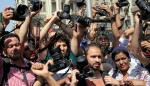 Egyptian journalists hold up their cameras during a protest against the interior minister following the arrest of colleagues for covering anti-government demonstrations, outside the Egyptian Press Syndicate in downtown Cairo, April 28, 2016. (photo by REUTERS/Mohamed Abd El Ghany)  Read more: http://www.al-monitor.com/pulse/originals/2016/05/egypt-press-syndicate-raid-arrests-sisi-cairo.html#ixzz48A1JrASg