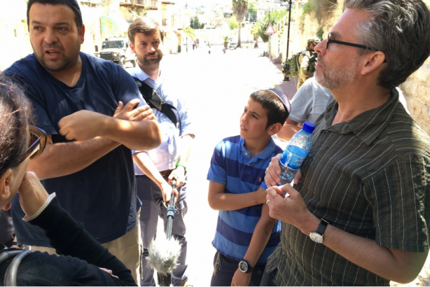 Writer Michael Chabon, right, speaks with a Jewish settler Ofer Ohana in Hebron, West Bank, in April. (William Booth/The Washington Post)